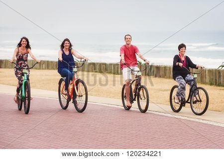 Mother and her fully grown children riding bicycles together