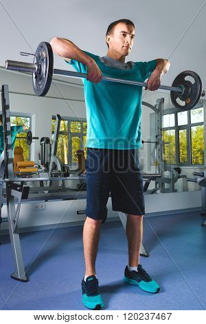Muscular Man Lifting Deadlift In The Gym