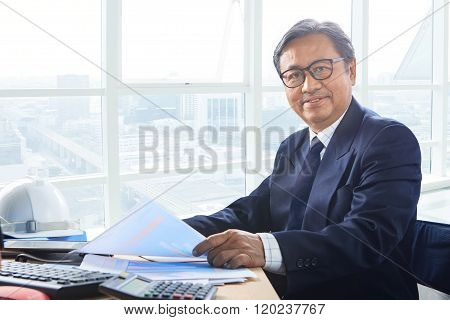 Senior Business Man Working On Office Table With Smiling Face Happiness Emotion