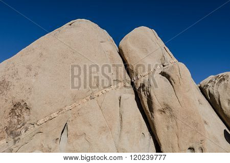 Seam Of Rock In Sandstone With Deep Blue Sky