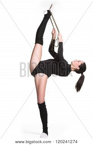 Young cute woman in gymnast suit show athletic skill with gymnastic rope on white background