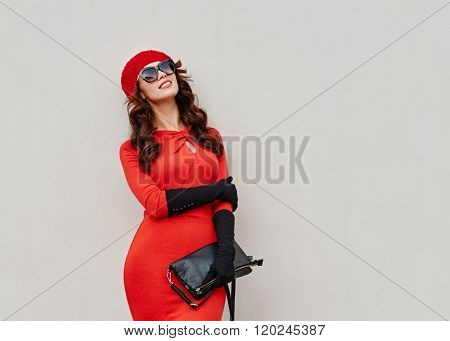 Elegant fashion young woman about the wall