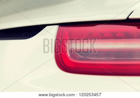 motor vehicle, transportation and driving concept - close up of car part with grille and headlight