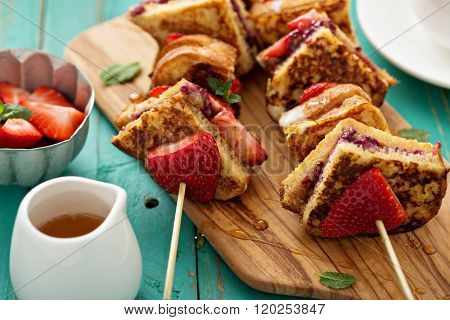 French toast pieces on a skewer with strawberry