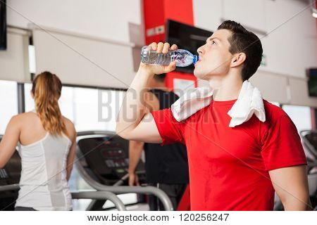 Man Drinking Some Water In A Gym