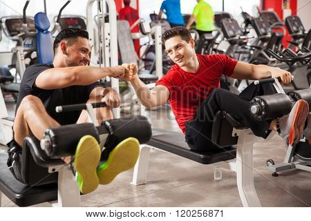 Bros Working Out Together In A Gym