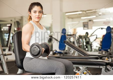 Pretty Hispanic Woman Lifting Weights
