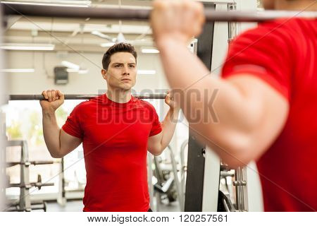 Man Doing Squats On A Smith Machine