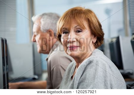 Portrait Of Happy Senior Woman In Computer Class