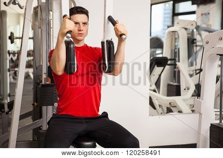 Young Man Exercising His Chest Muscles