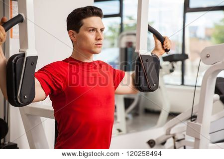 Focused Man On A Peck Deck Machine