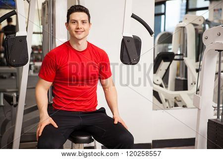 Happy Young Man Exercising At The Gym