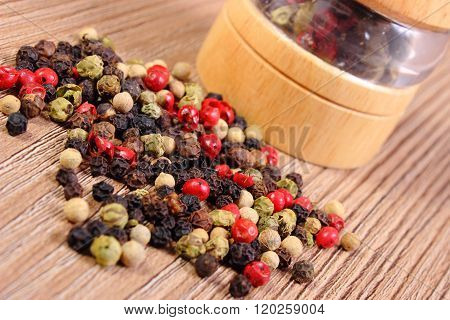Pepper With Mill On Wooden Background
