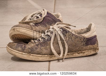 Dirty Shoes With Mud And Soil