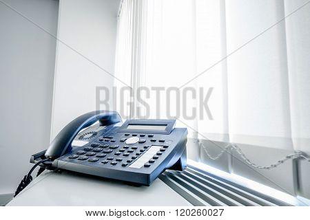 Telephone In An Office Window