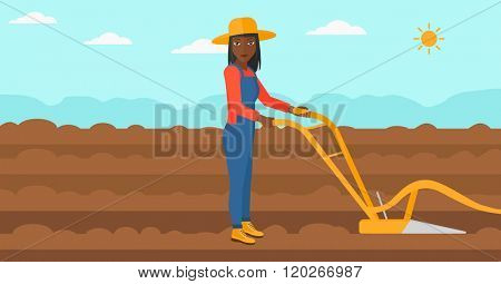 Farmer on the field with plough.