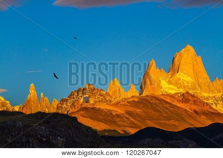 The stunning Patagonia. Fiery sunset illuminates the spectacular cliffs Fitz Roy