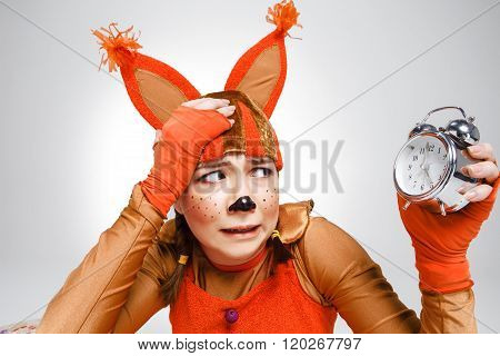 Young woman in the image of red squirrel