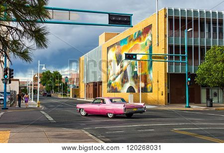 Albuquerque U.S.A. - May 23 2011: New Mexico mural paintings along the Route 66 with a vintage car crossing.
