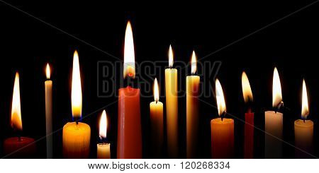 Set Of Candles In The Dark