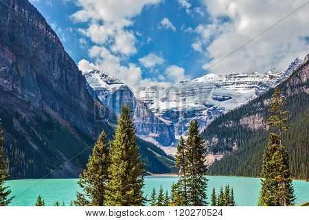 Rocky Mountains, Canada, Banff National Park. Magnificent Lake Louise is surrounded by mountain peaks and glaciers. Great sunny day