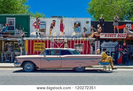 Seligman, U.S.A. - May 25, 2011: Arizona, a vintage car with dummies in front of a store on the Route 66.
