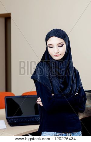 Portrait, Of, A, Beautiful, Muslim, Woman, Standing, In, Office, With, Closed, Eyes.