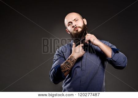 Bald Man With A Beard Cut Off His Beard