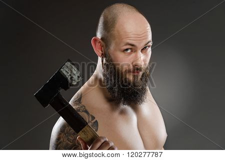 Topless Bearded Man Holding Old Axe