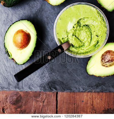 Guacamole. Avocado On A Black Background