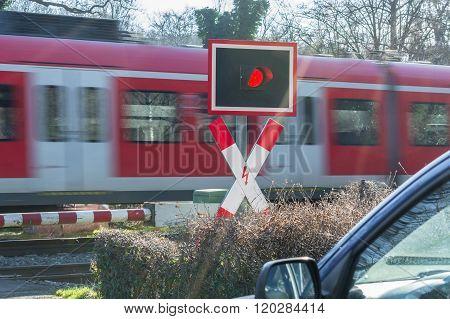 Passenger Train Transit At The Railroad Crossing