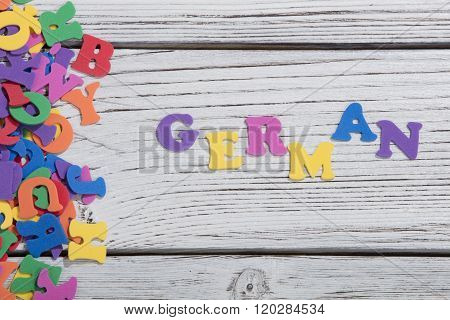 many colorful words on white wooden background, german