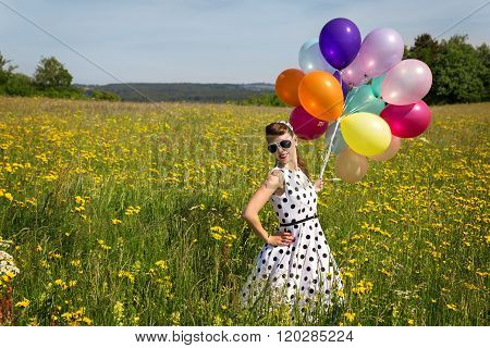 Beautiful Pinup Girl With Balloon On A Meadow