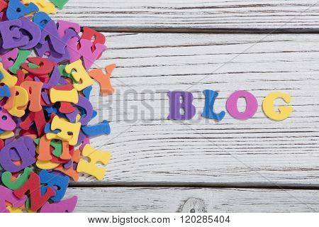 many colorful words on white wooden background, blog