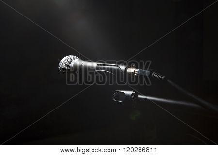 Black Microphone On Black Dark Background.
