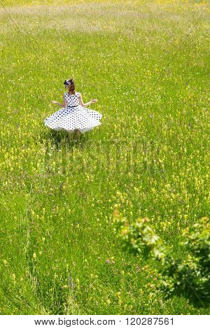 Pin Up Girl Is Twisting In A Wildflower Meadow