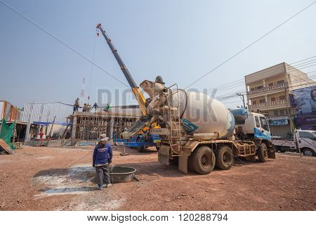 Concrete Mixer Truck Pouring Cement At Construction Site