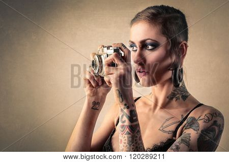 Tattooed woman taking pictures