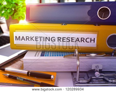 Marketing Research on Yellow Ring Binder. Blurred, Toned Image.