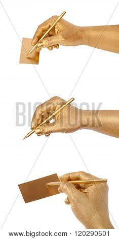 Man's golden hand writes on card by a pencil