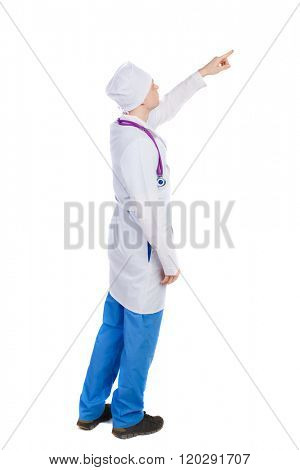 Side view of doctor in robe pointing. Standing young man. Rear view people collection. The nurse or doctor pointing up