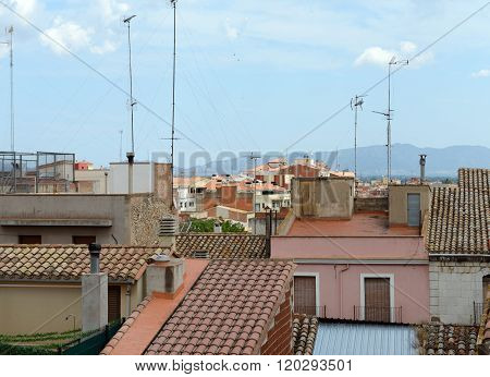 Tiled Roofs Of Old Buildings In Figueres, Catalonia, Spain.