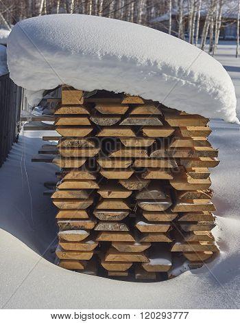 stack pile under snow.
