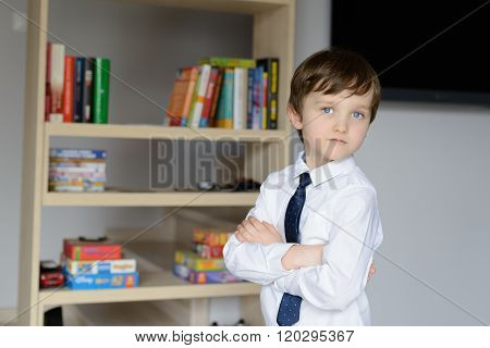 Elegantly Dressed In A White Shirt And Tie Little Boy.