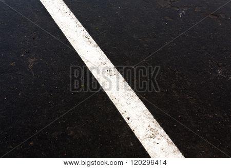 Traffic Line On Dirty Ashphalt Road