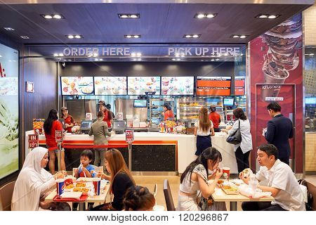 BANGKOK, THAILAND - JUNE 21, 2015: interior of KFC restaurant. KFC is a fast food restaurant chain that specializes in fried chicken and is headquartered in Louisville, Kentucky, in the United States