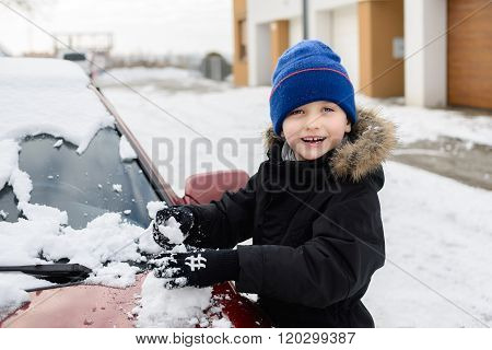 Child Playing With Snow Outside.