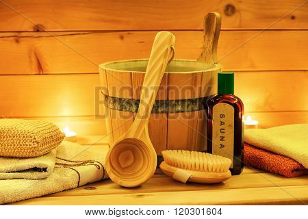 Sauna oil wooden bucket with ladle in closeup