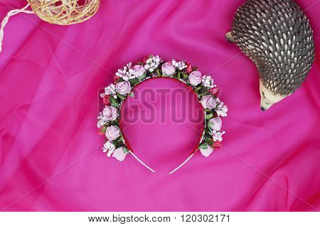 Hoop from flowers, wreath with colored flowers. Handmade flowers wreath on white. Accessory.