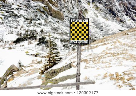 Black And Yellow Avalanche Risk Warning Sign In The Mountains